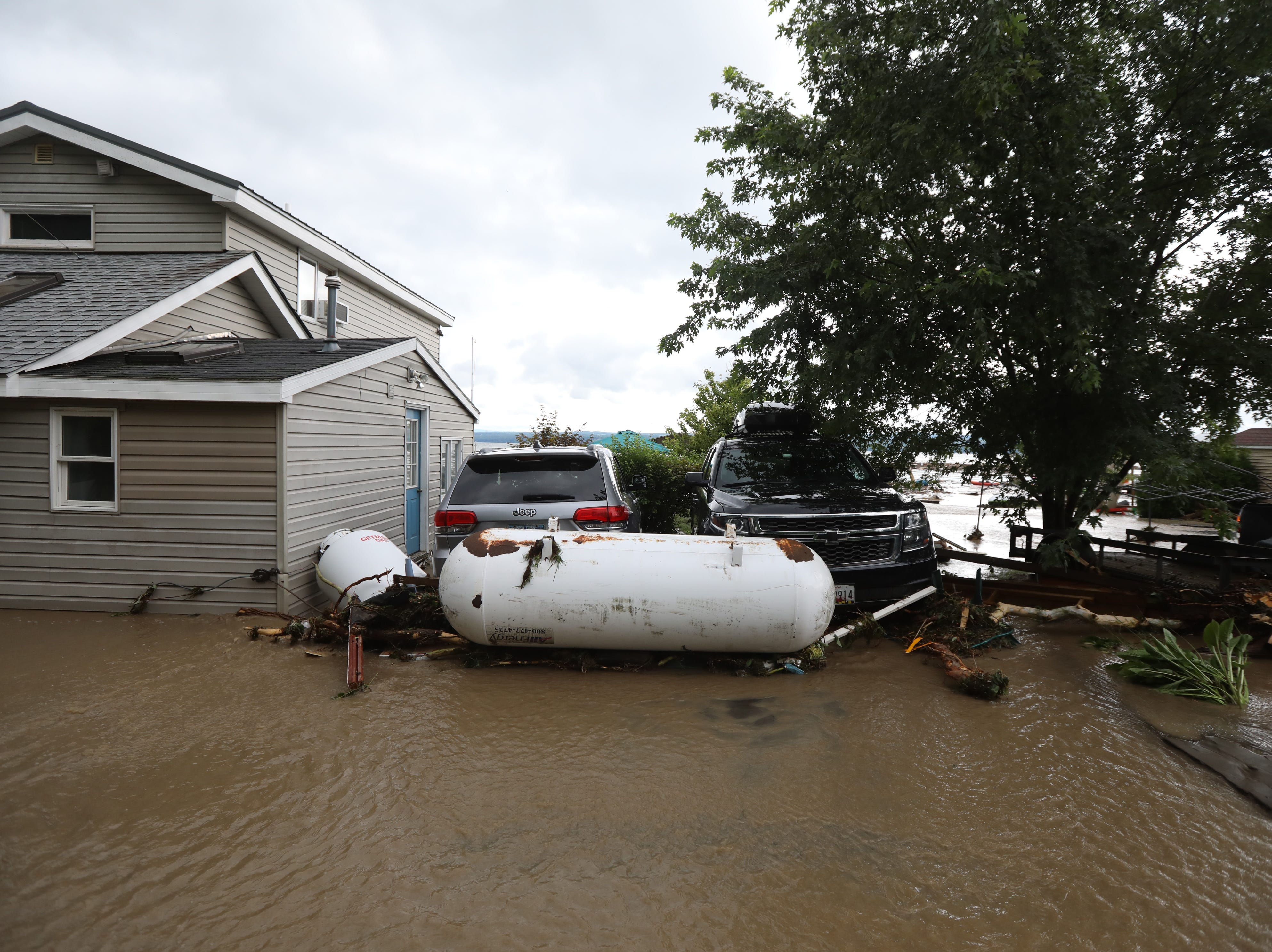 Propane tanks were pushed against vehicles on Lodi Point after heavy rain caused flooding and washing away at Lodi Point, New York on Tuesday, August 14, 2018.