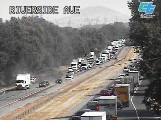 A traffic camera shows traffic backed up on both sides of Interstate 5 between Redding and Anderson after an oak tree fell across the northbound lanes.