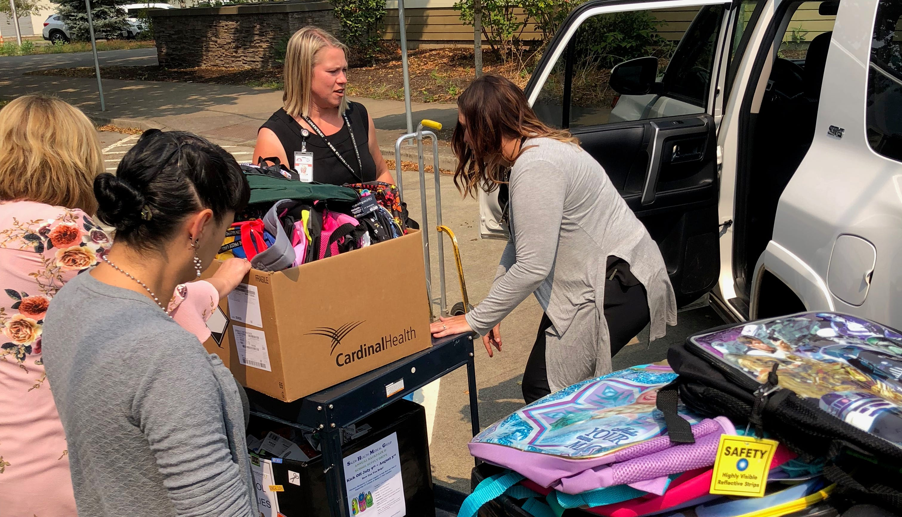 Salem Health employees deliver more than 3,500 backpacks to 31 schools