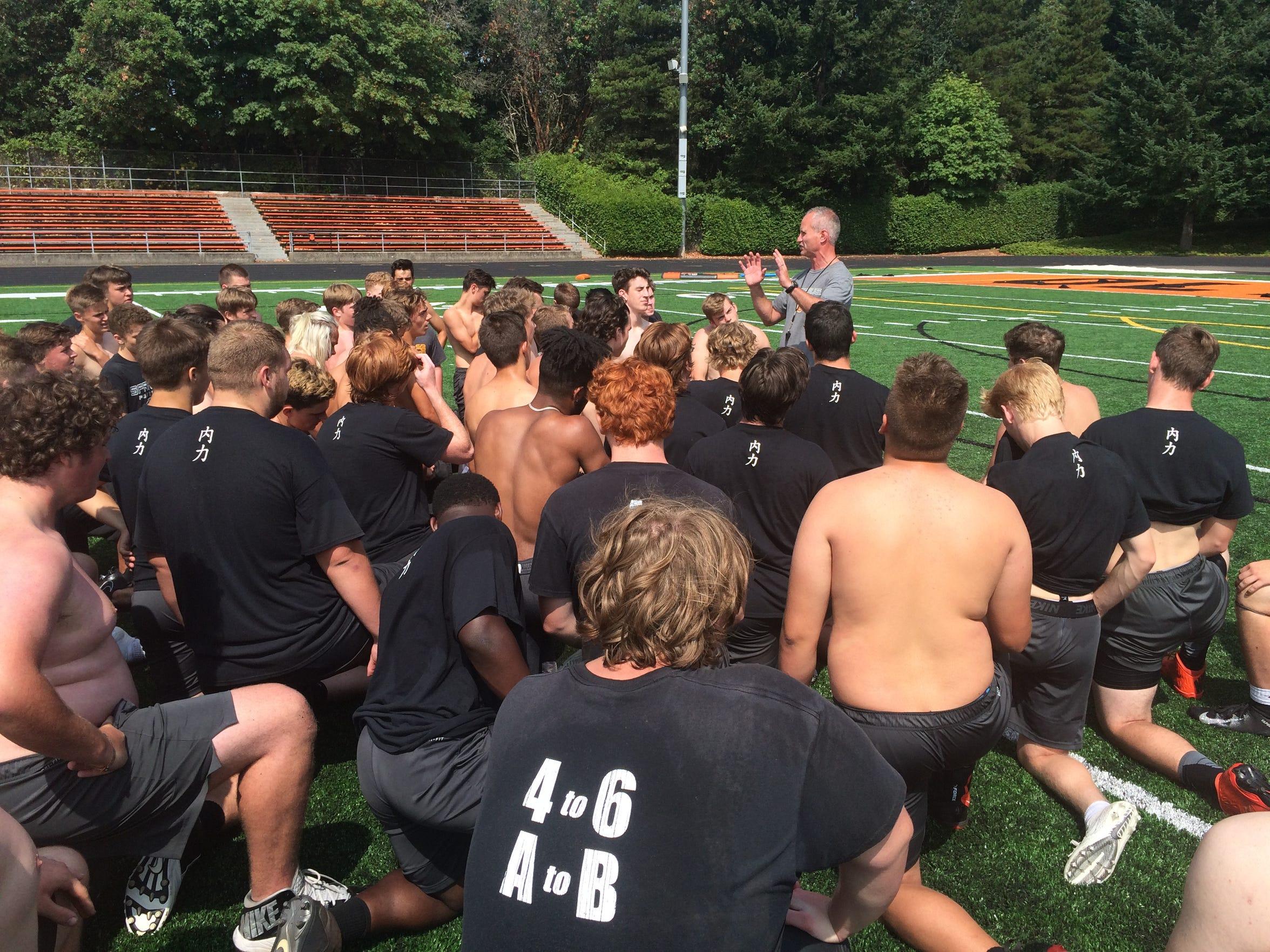 Sprague football coach Jay Minyard addresses the team after practice Monday, Aug. 13, 2018.