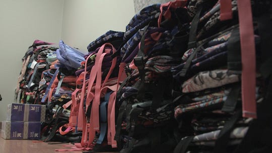 Stacks of backpacks in a fourth-floor lab in Building C on the Salem Hospital main campus await delivery to 31 schools in Marion and Polk counties. The backpacks were collected by employees with Salem Health Medical Clinics.