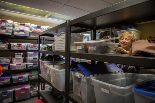 Jayne Downing, Executive Director of the Center for Hope and Safety looks through a boxes of donations for clients at the center in Salem, Monday afternoon August 13, 2018.