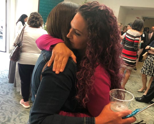 Mylene Peralta and Holly Lombardi hug during an open house for the Nancy Ausonio Mammography  Center last week. Peralta is an RN and Lombardi is an ultrasonographer who helped detect Peralta's breast cancer in 2017 at the Center.