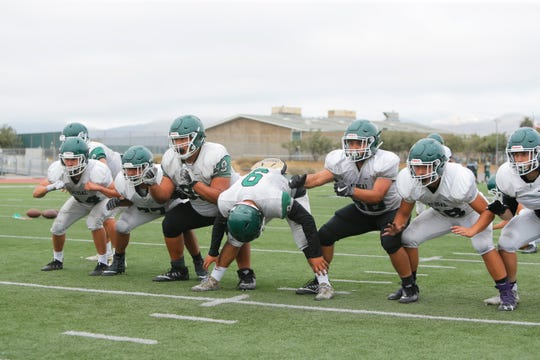 One of the areas Trojan head coach Cesar Chaidez feels most confident in is the team's offensive line. Shown here in field goal formation, 2017 Pacific Division Co-Offensive Lineman of the Year Isaac Duenas (fourth from left) leads a team returning all five starters.