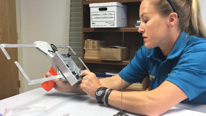 Investigator Tara Leckel of the Northampton County Sheriff's Office demonstrates use of a receiver, associated with the Project Lifesaver program, that helps officers locate missing persons more quickly, on Monday, Aug. 13, 2018 in Eastville, Virginia.