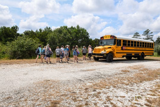 New Accomack County teachers load into a schoolbus after touring the Brownsville Preserve on Monday, August 13.