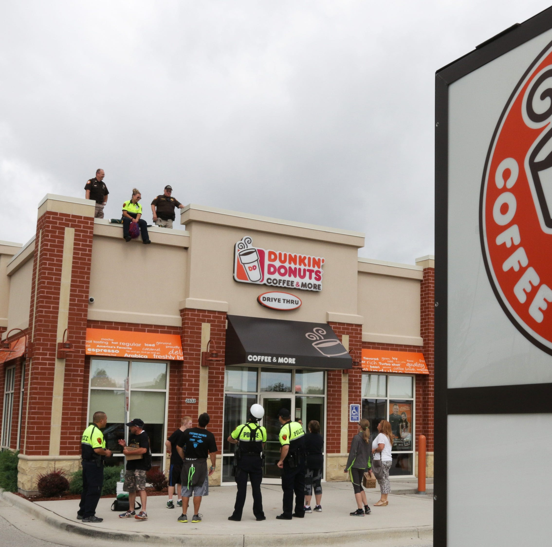 Cop on a Rooftop returns to Sheboygan's Dunkin' Donuts | Arts Notes