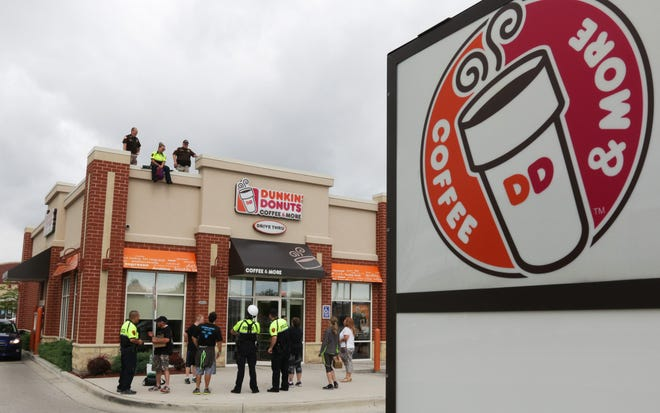 Area law enforcement people were on hand during a fund raiser for Special Olympics of Wisconsin Friday August 11, 2017 at  Dunkin' Donuts in Sheboygan, Wis.  Officers spent time on the roof to bring attention to the fund raiser.