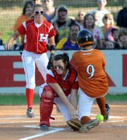 Northwood's Kaitlyn Williams (9) slides into home against Haughton's Shyanne McDowell during a 2011 game.