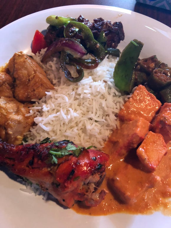 A sampling of lunch buffet items at Himalayan includes basmati rice, chicken curry, chicken tikka masala, chili chicken, tandoori chicken and vegetable dishes.