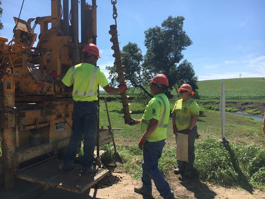 Workers with boring equipment: State workers bore into soil on the edge of a bridge that needs replacing in Deuel County. The work is the first step to help determine what can be done with the structure.