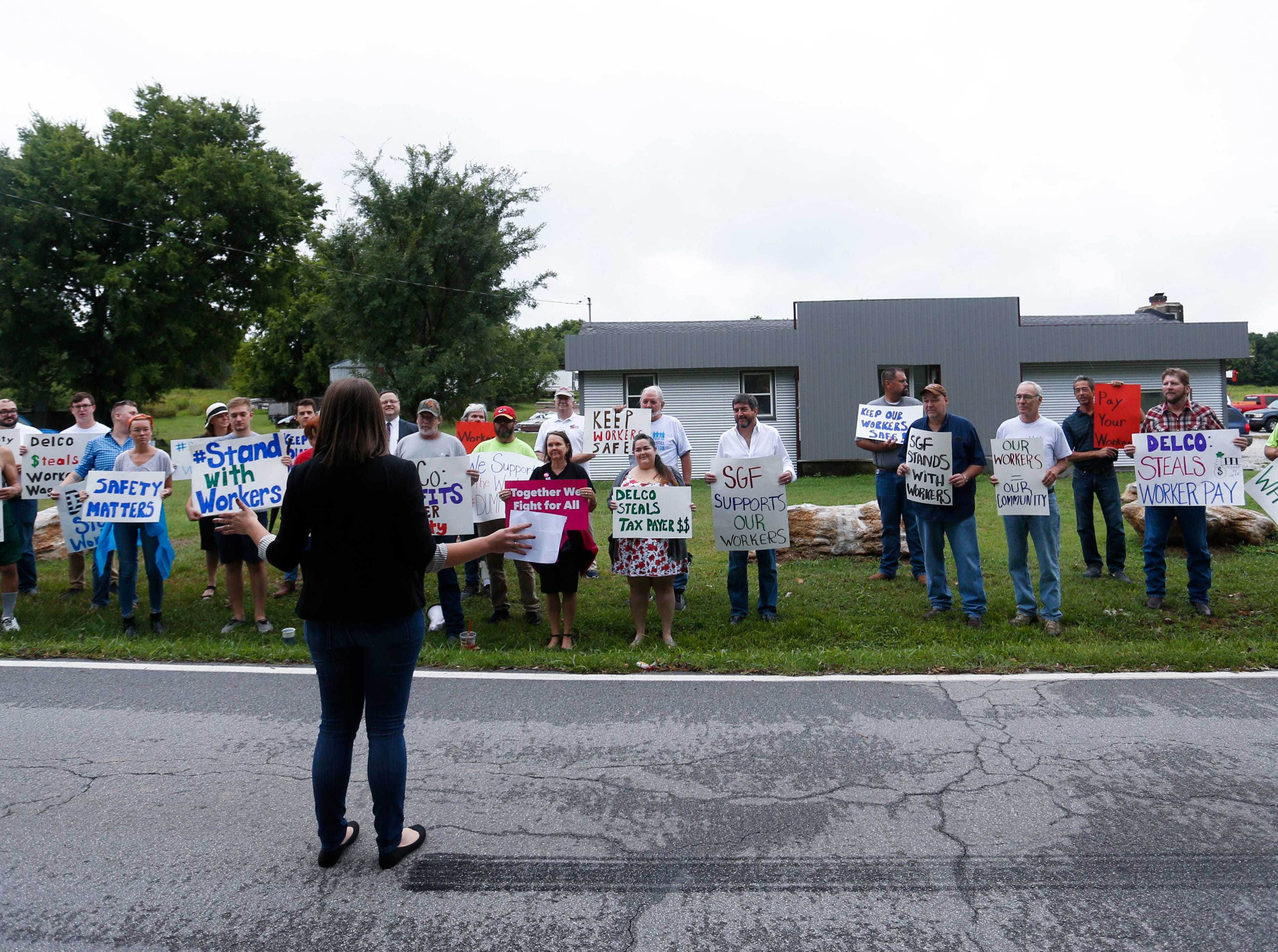 Rep. Crystal Quade, D-Springfield speaks to a group of protestors outside DelCo Construction on Tuesday, Aug. 14, 2018. Protestors claimed that DelCo and its owner, Jeff Delmont, subject workers to unsafe conditions, low wages, and inadequate training.