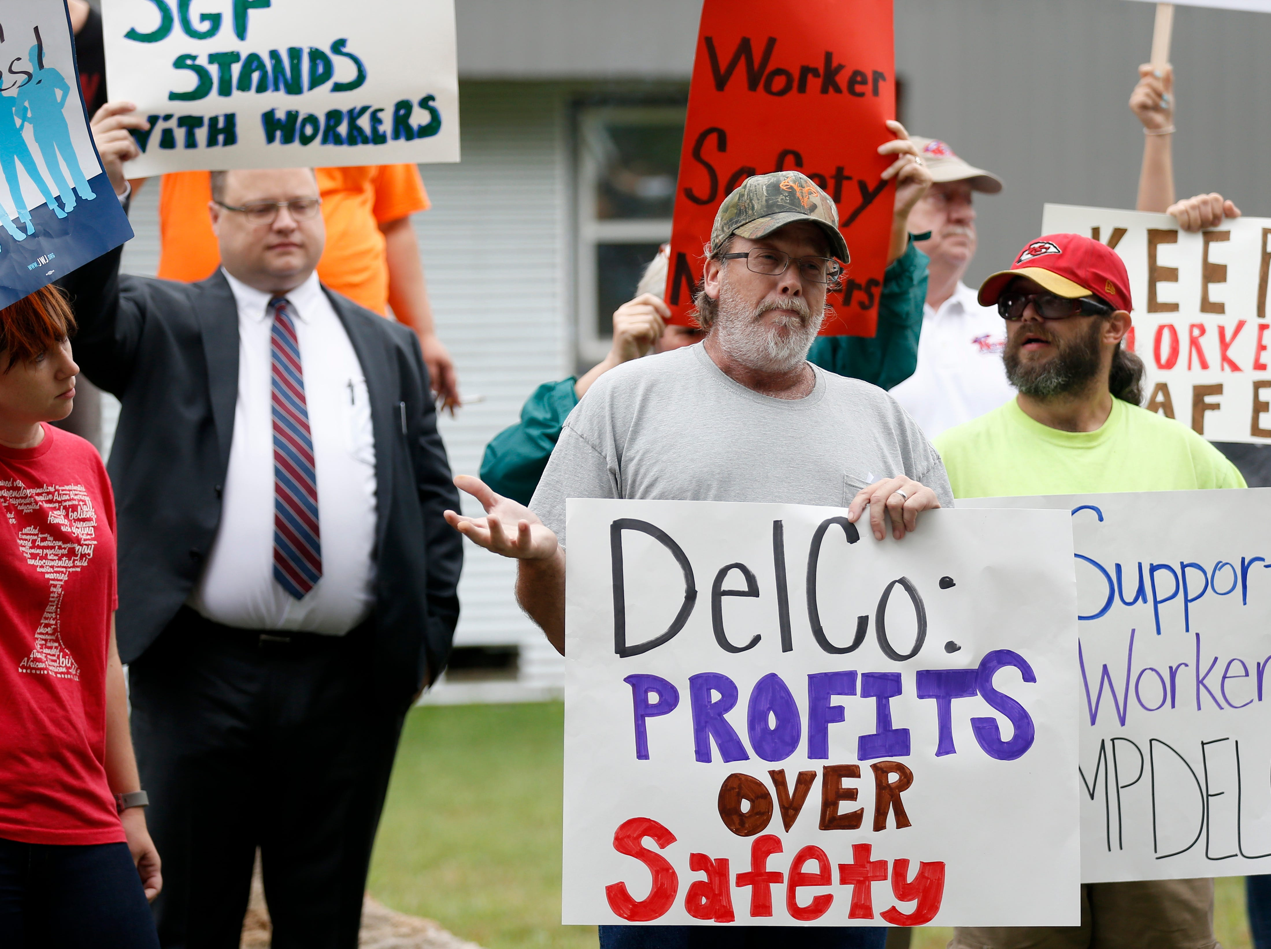 Protestors Mike Morrison (left) and Chris Choates speak about the working conditions at DelCo Construction outside the business on Tuesday, Aug. 14, 2018. Protestors claimed that DelCo and its owner, Jeff Delmont, subject workers to unsafe conditions, low wages, and inadequate training.