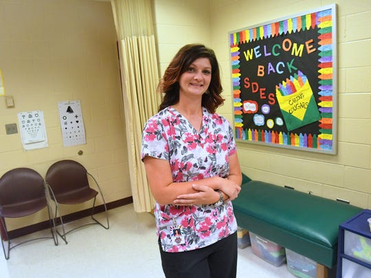 Nicole Babinger serves as a school nurse at Stuarts Draft Elementary. She is photographed in the school's nurse's clinic on Tuesday, August 14, 2018.
