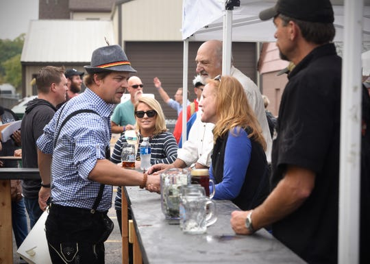 People line up for mugs of Oktoberfest beer during the 2016 celebration at Beaver Island Brewing Co. in St. Cloud.