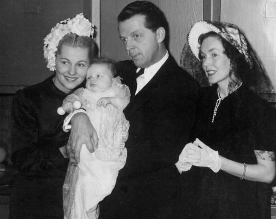 Joan Fontaine and William Dozier at daughter Deborah's christening, with godmother and actress Maureen O'Sullivan, right, who was the mother of actress Mia Farrow.