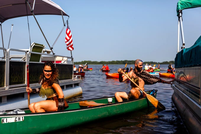 A team launches their canoe for PaddleQuest Odyssey in Stevens Point, Wis., August 11, 2018.