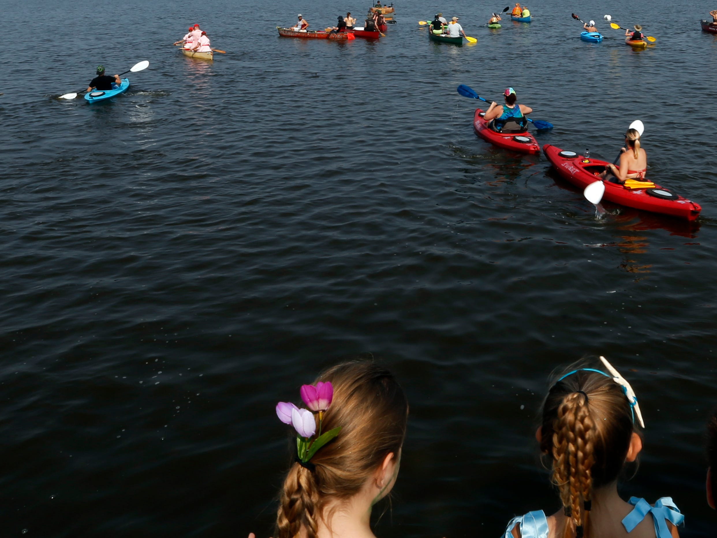 Children look on as questers take off for PaddleQuest Odyssey in Stevens Point, Wis., August 11, 2018.