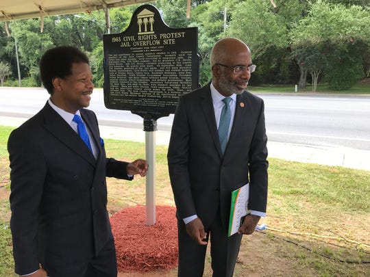 Leon County Commissioner Bill Proctor, left and Florida A&M University President Larry Robinson, right, chat following the unveiling of a civil rights marker on Tuesday, Aug. 14, 2018 at the North Florida Fairgrounds.