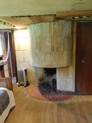 The master bedroom has a circular hooded fireplace.