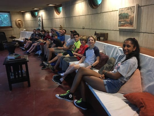 Campers enjoy the primary seating in the living room. The low wood seat runs the entire length of the west wall.