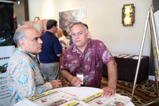 Steve Ghazvini, center, developer of the Canopy at Welaunee, during the annual Tallahassee Chamber Conference at the Omni Amelia Island Plantation on Saturday, Aug. 11, 2018.