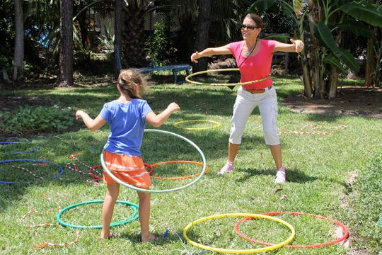 Florida Department of Health Martin County's Mary Beth Peña demonstrates fun and easy ways to exercise and stay healthy.