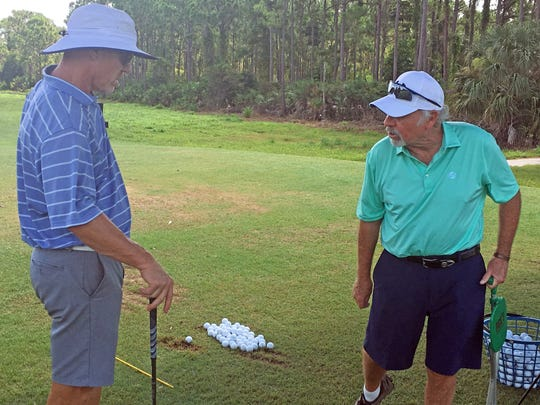Jimmy Ballard (right) works with DJ Morris at The Champion Club in Stuart.