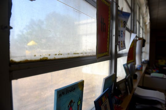 Some windows in classrooms at Jensen Beach Elementary School are permanently fogged over due to damage from hurricanes over the years prohibiting students to see outside. The windows are just one of the things on a laundry list of repairs needed at the school built in 1970.