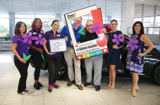 Alzheimer's Association volunteers Yvette Cruz, left, Andele Ansola, and Christine Rigg are celebrated by Dyer Chevrolet's Will Dyer, Jonathan Holmes and Tatiana Dyer. Audra Afflitto, far right, accepts the August Dyer Difference Charity Month Award on behalf of the Alzheimer's Association.