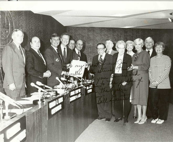 "James Vocelle's lifelong accomplishments led  Gov. Bob Graham to declare Nov. 13, 1984 as  ""Jim Vocelle Day"" throughout Florida. Vocelle, center, accepts the proclamation as family members look on.  From the left are Commissioner of Agriculture Doyle Conner, Secretary of State George Firestone, Graham, State Insurance Commissioner Bill Gunter, Attorney General Jim Smith and  Commission of Education Ralph Turlington."