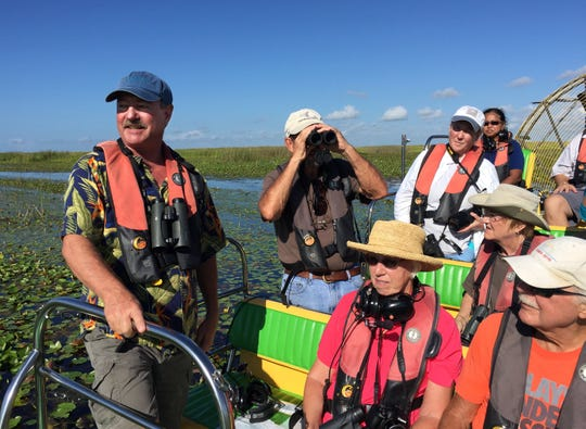 Paul Gray, left, shows a group from the Martin County Audubon Society around the marshes of Lake Okeechobee.