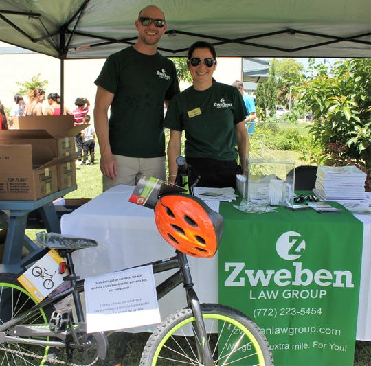 The Zweben Law Group's Gene Zweben and Kristen Bishop offered bike safety information and a raffle, where one lucky participant won a brand-new bicycle.
