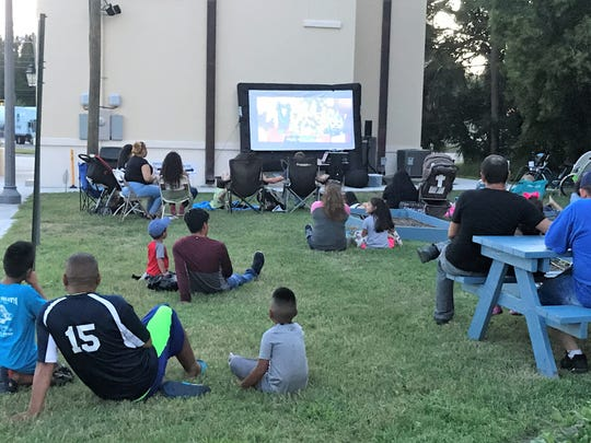 "Over 60 guests enjoyed a breezy summer evening watching Disney Pixar's ""Coco"" in the Golden Gate Center for Enrichment's nutrition garden in Stuart."