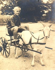 Joe Michael pilots his goat cart, he's about 10 years old in this picture taken around 1928.