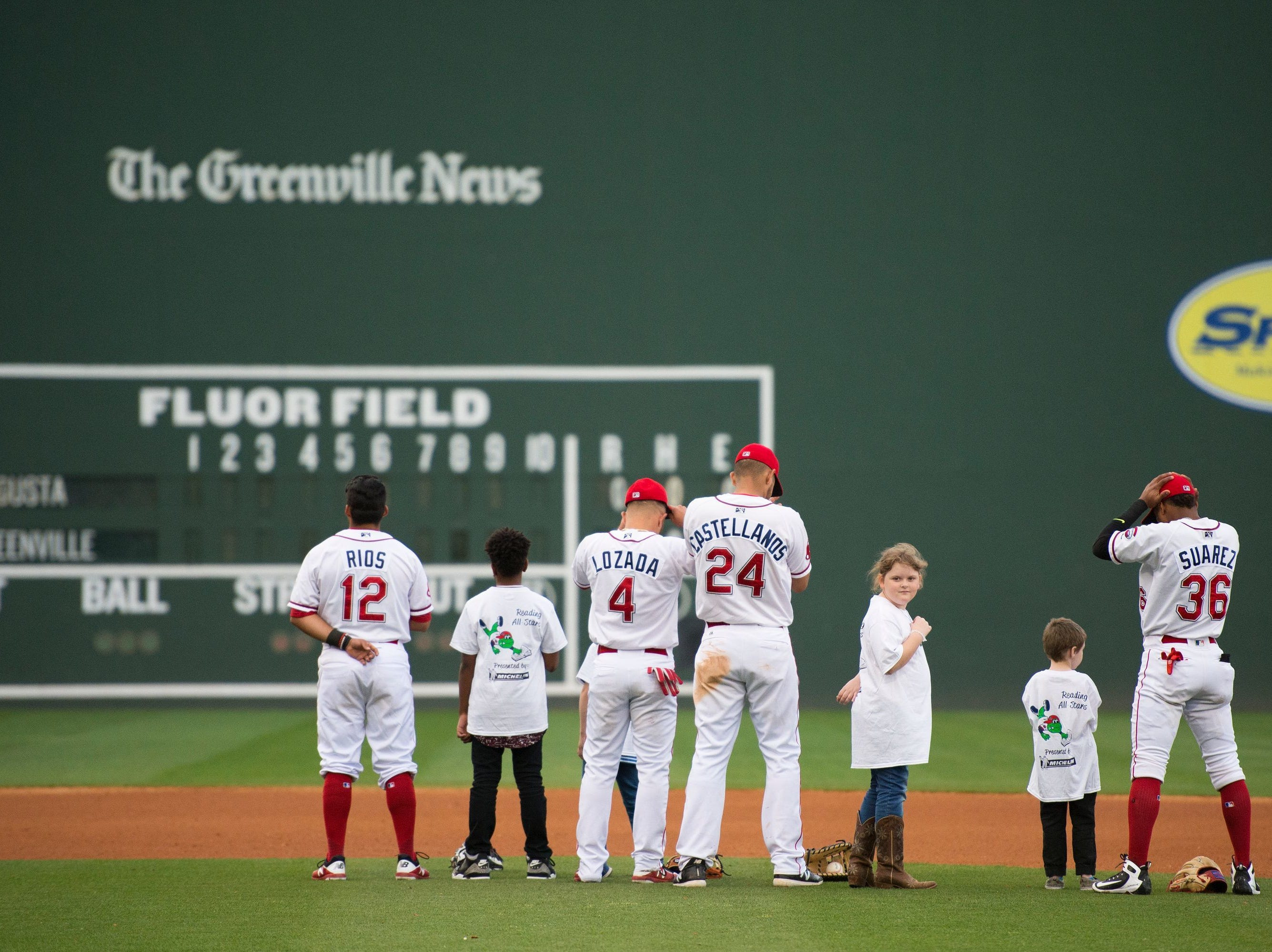 Students join Drive players for the National Anthem during the Reading All-Stars Celebration Game at Fluor Field in April.