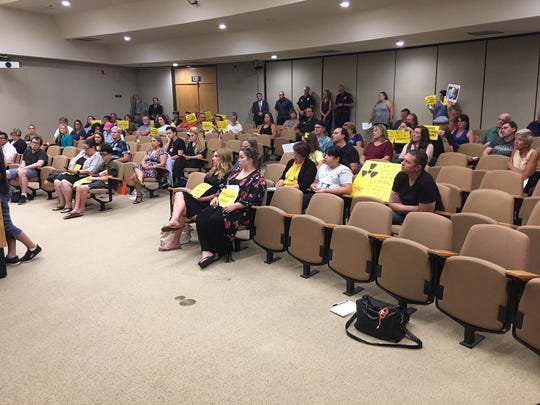 About 20 people urged the Simi Valley City Council Monday night not to let the city use groundwater as drinking water for residences, arguing it is contaminated by the nearby Santa Susana Field Laboratory and likely cancer-causing.