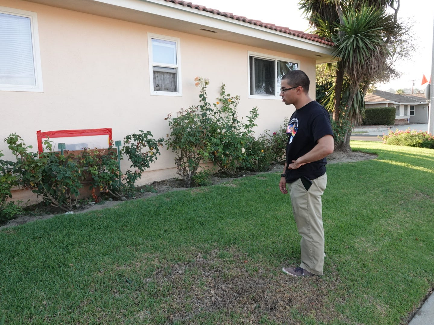 Ross Fandey looks at the patched wall of his family's Camarillo home where an SUV crashed on Father's Day. The city recently installed four-way stop signs at the intersection of Lantana and Coe streets, which residents had been requesting for years because of such incidents.