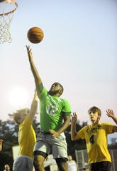 Donald Carter of team Ag Auto shoots the ball during the Vineland Basketball Association 15-18 Championship Game against Custom Graphics at Pagliughi Park on Monday. 08.13.18.