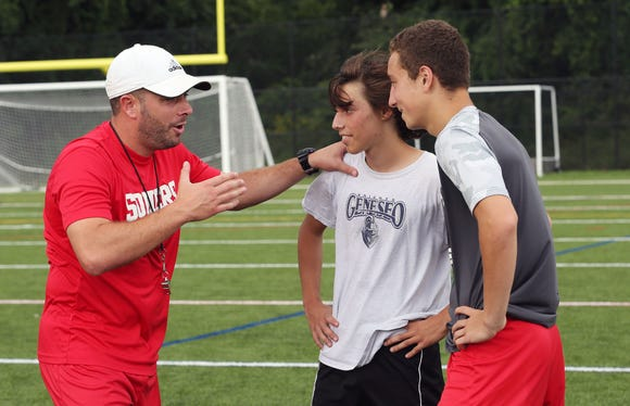 From left, Somers soccer coach Brian Lanzetta speaks with Lucas Fecci and Alex Maher after practice at Somers High School Aug. 14, 2018.
