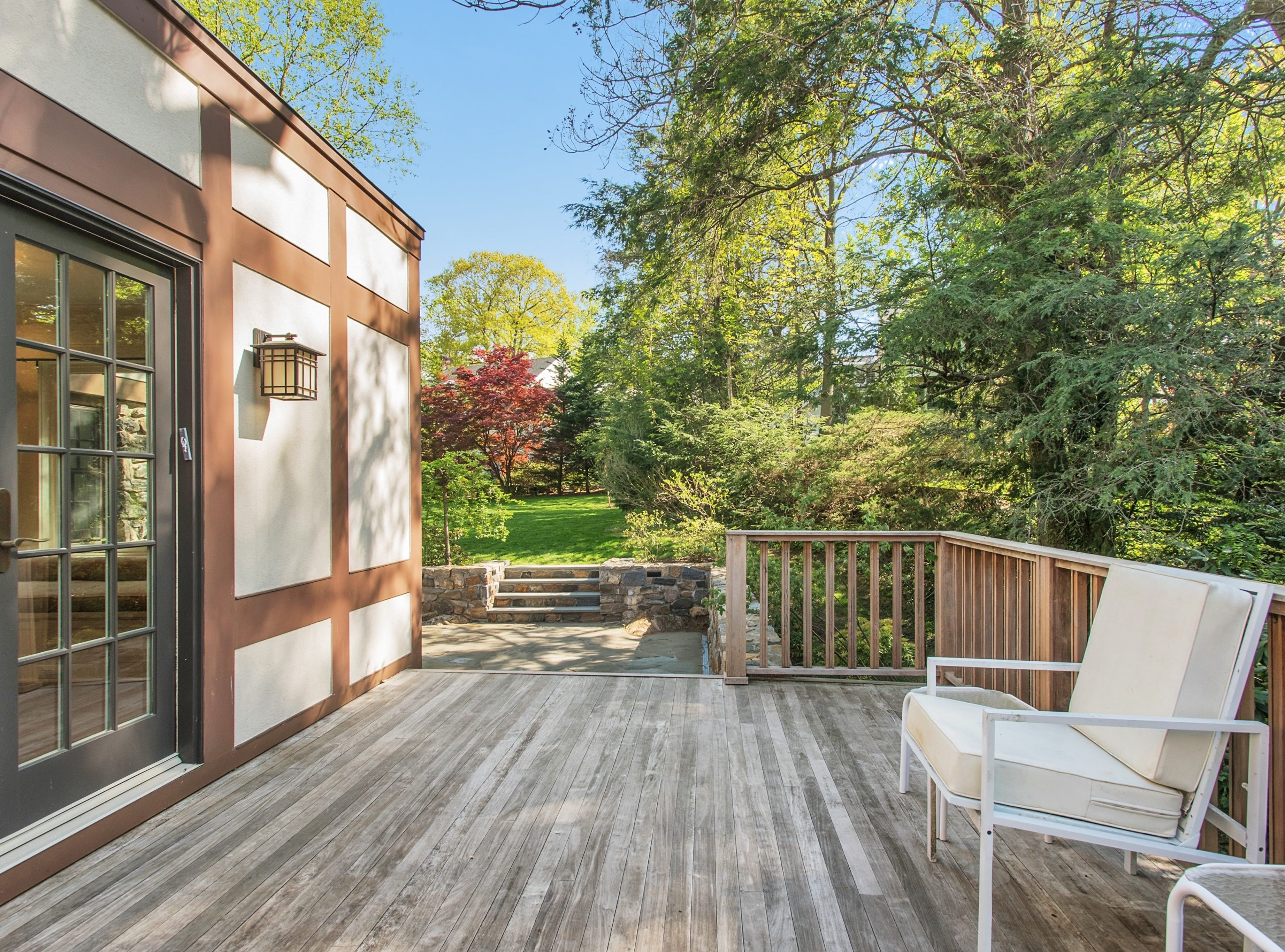 The outside is quiet and private and features an expansive deck.