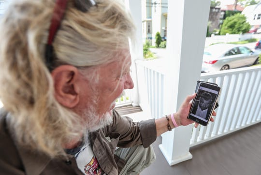 Sherwood Martinelli, 62, views a photo on his phone he took of actor Liev Schreiber moments before he claims he was attacked by the actor on Lydecker Street in Nyack on June 7th.  Tuesday, August 14, 2018