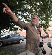 Sherwood Martinelli, 62, points to the location on Lydecker St. in Nyack on Tuesday, August 14, 2018, where he claims actor Liev Schreiber charged and attacked him on June 7th while filming on the set of 'Ray Donovan.'