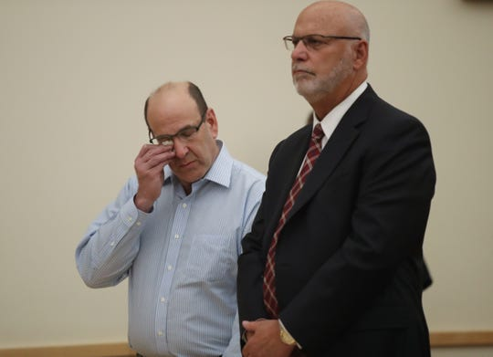 David 'Skip' Storch, 61, left, wiping tears from his eyes, with defense attorney David Goldstein during the sentencing phase of his trial at the Rockland County Courthouse in New City on Tuesday, August 14, 2018.  Storch was sentenced to 7-years in prison.