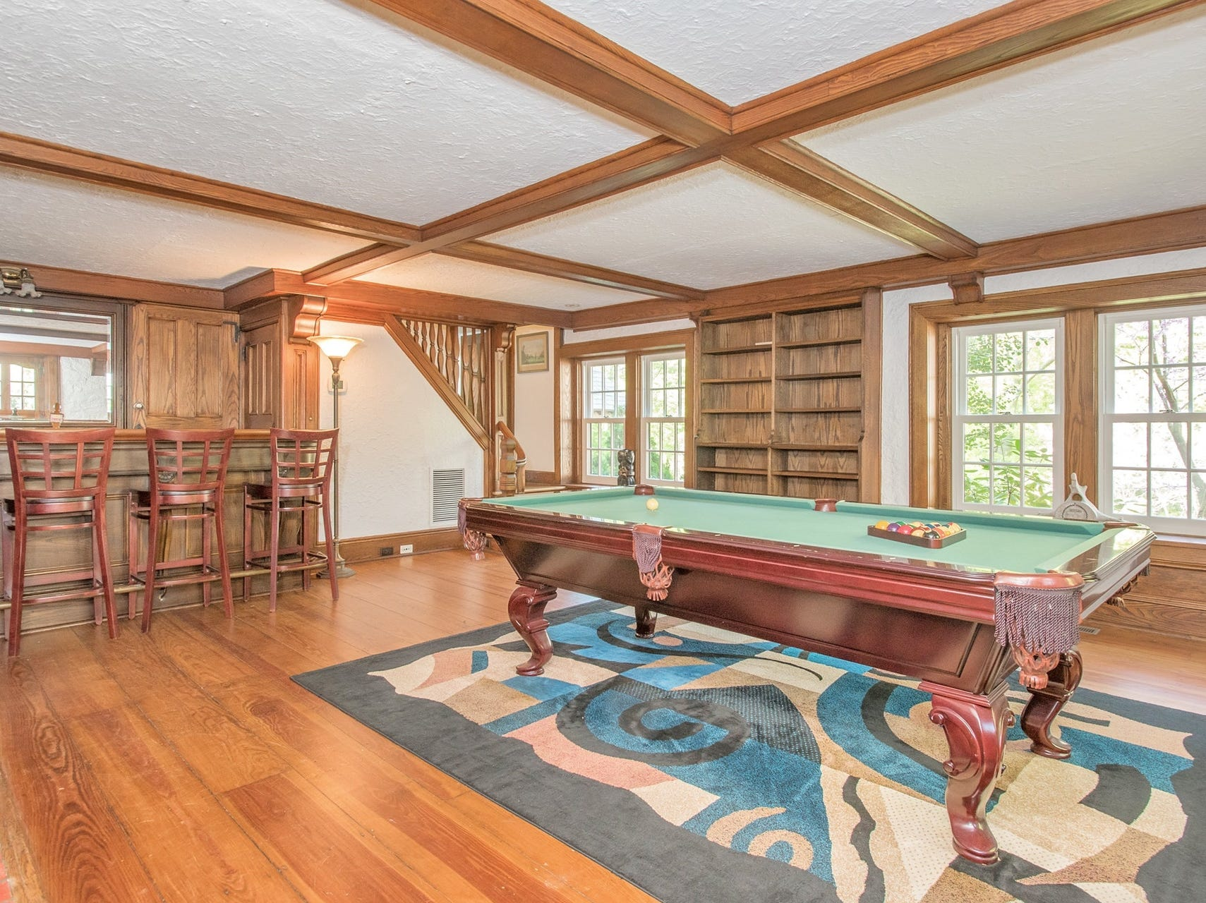 The lower level billiards room has an original hardwood door.