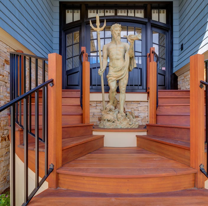 Neptune guards this three-story Delaware coast house
