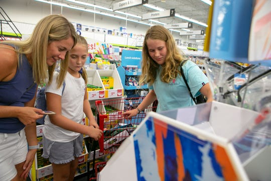 Pennsylvania residents, Kristen Cornatzer (from left) and her daughters Kendra, 11, and Kylie, 13, shop for school supplies at Staples on Kirkwood Highway.