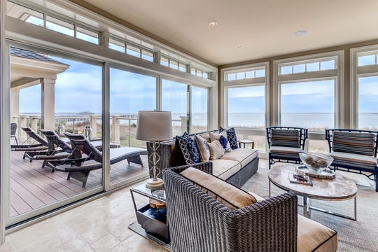 The back of 126 Breakwater Reach offers expansive views of the Delaware Bay and Atlantic Ocean.