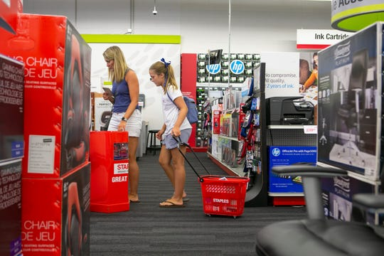 Kendra Cornatzer, 11, shops for school supplies with her mom, Kristen and sister at Staples on Kirkwood Highway.