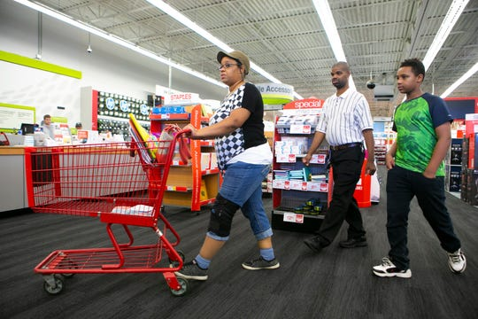 Donovan Lewis (right), a 6th grader going to A.I. du Pont Middle School shops for school supplies with his mom Latrece and uncle at Staples on Kirkwood Highway.